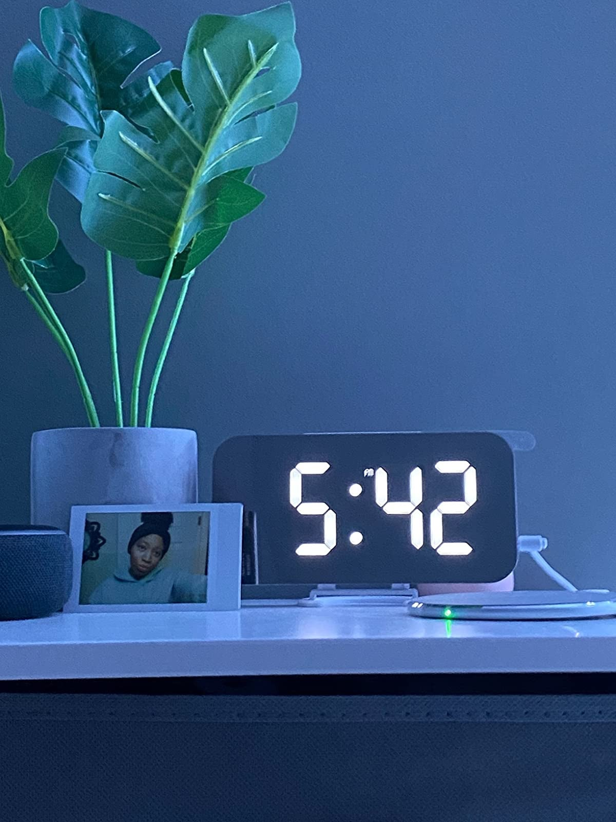 a reviewer's bright mirrored clock