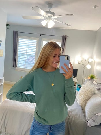 reviewer in the green crewneck
