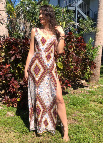 reviewer wearing the maxi dress with slit