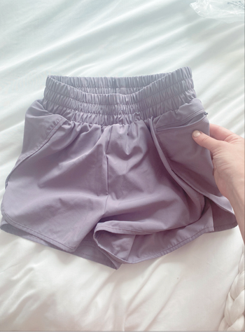 The shorts with editor showing small zippered side pocket