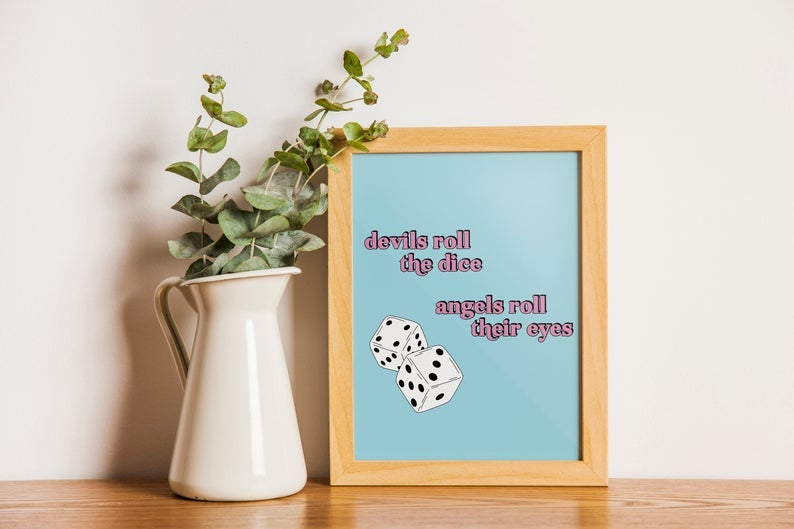 blue print with illustrated dice and pink text reading