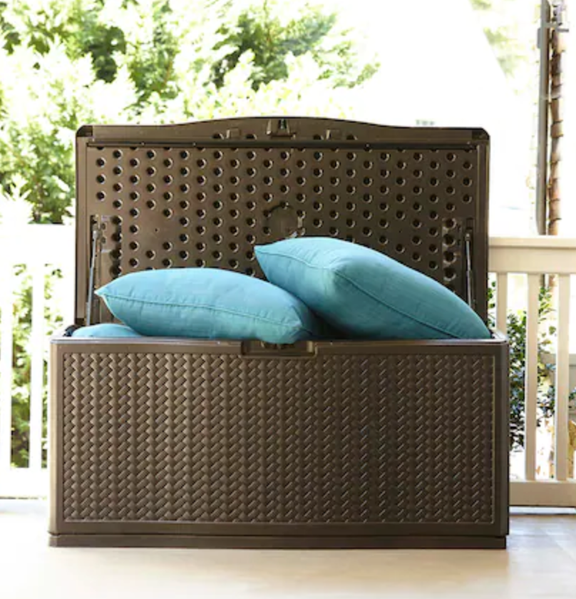 plastic deck storage container with pillows stored in it