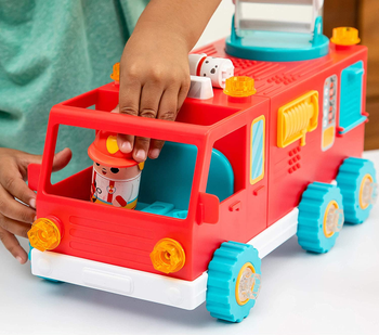 Child model playing with plastic red fire truck toy