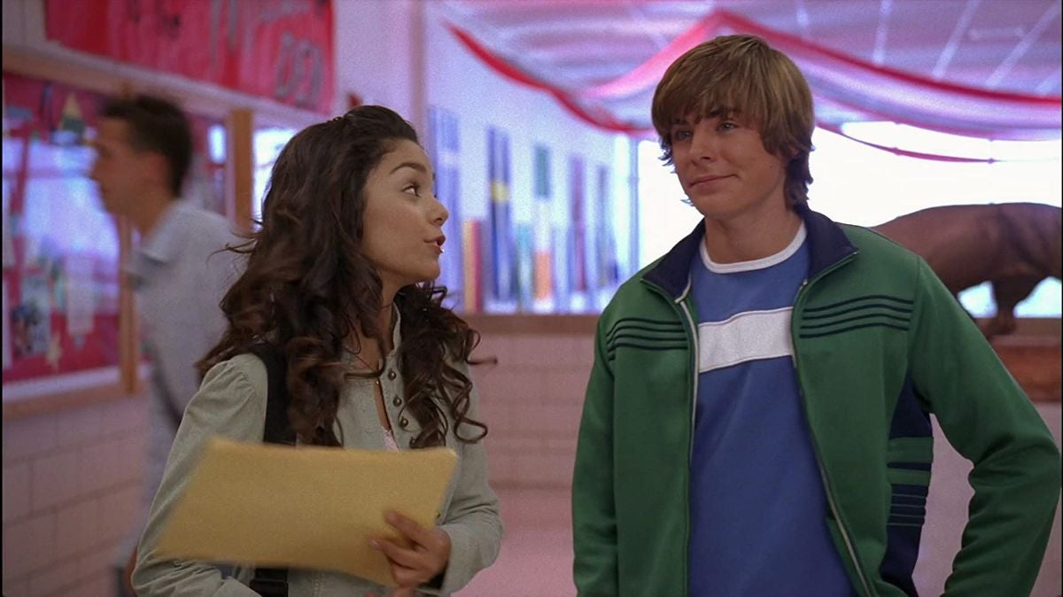 """Vanessa Hudgens and Zac Efron talk in the middle of the school hallways as Troy and Gabriella in """"High School Musical"""""""