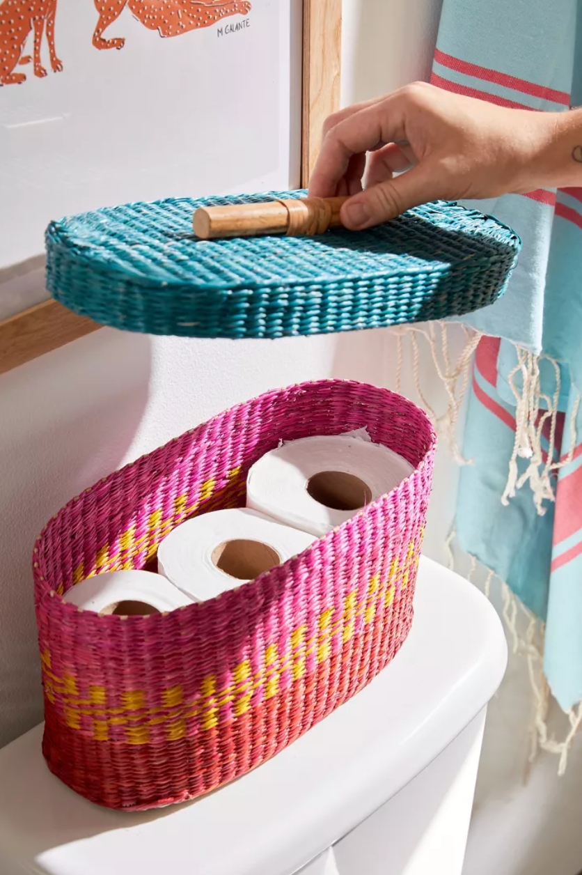 colorful oval basket with three rolls of toilet paper inside