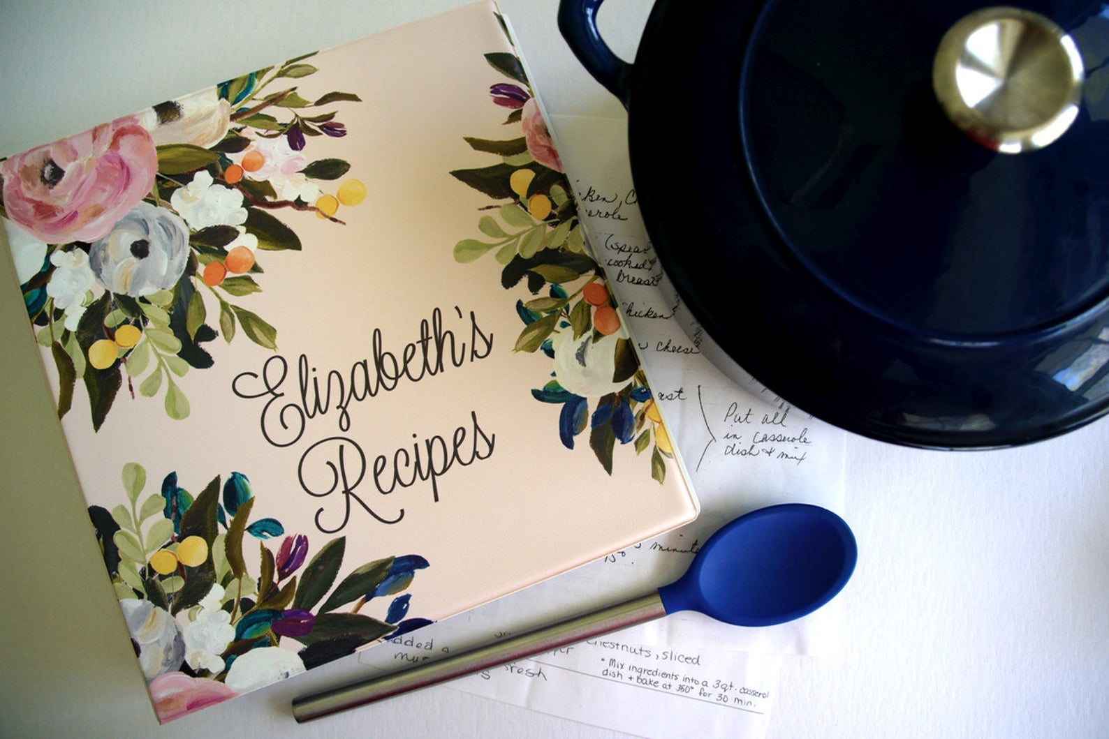 a floral recipe binder personalized with text that reads