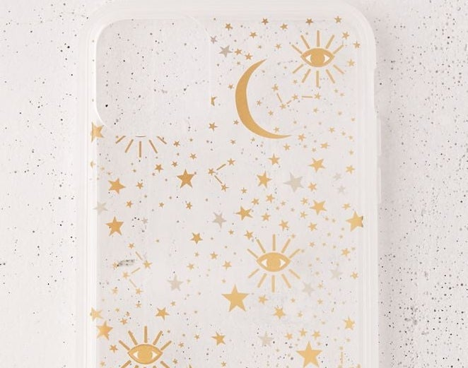 A phone case with stars, constellations, and eyes on it