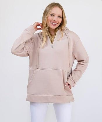 model wearing the dusty rose, oversized hoodie