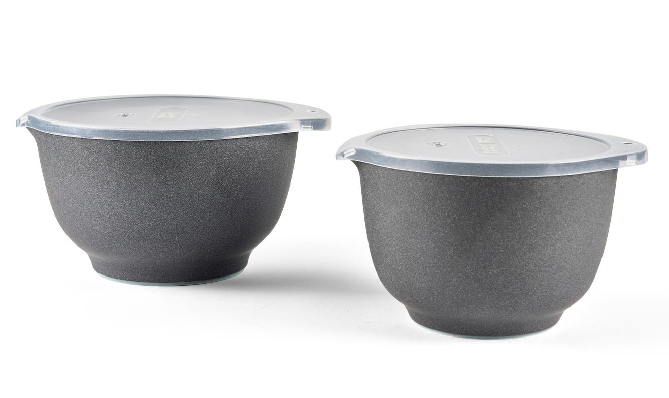 the two grey mixing bowls with plastic lids