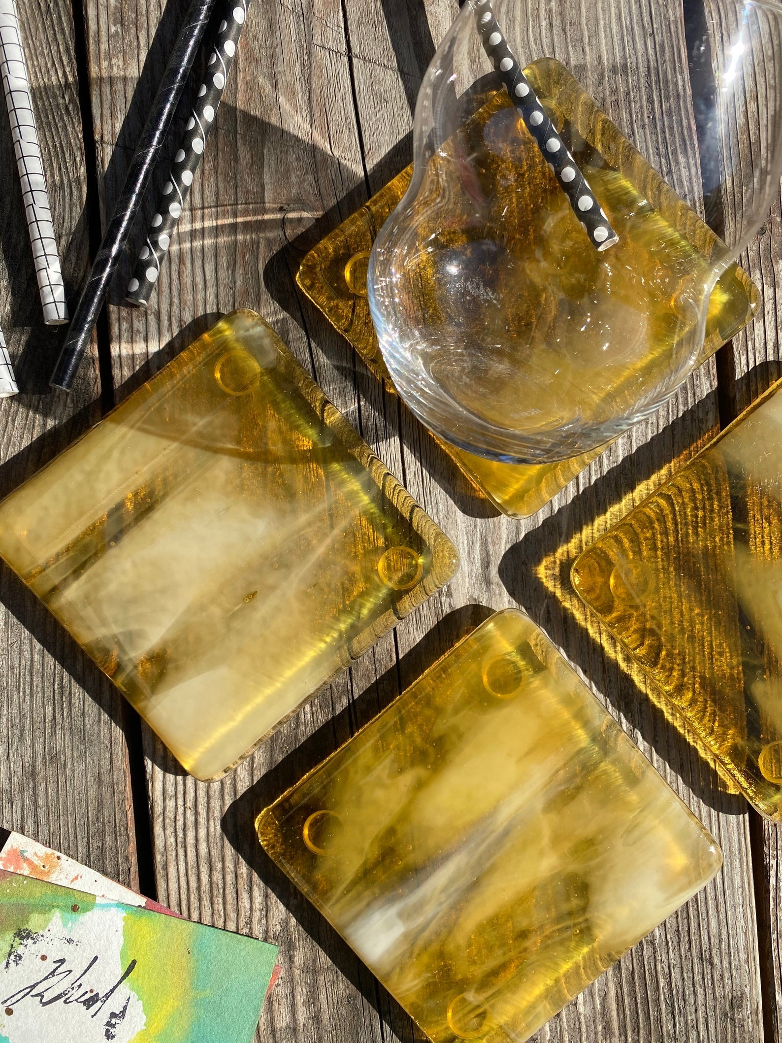 the lemon ice colored marbled glass coasters on a table