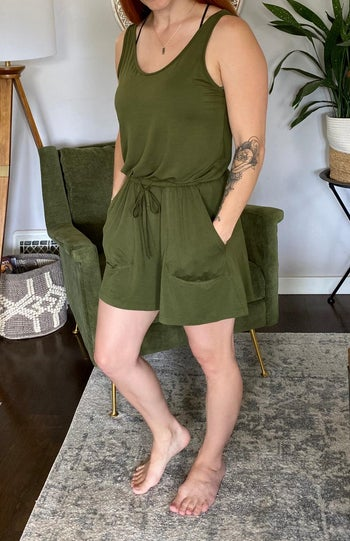 a different reviewer wearing the romper in army green