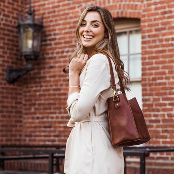 a model using a brown tote bag