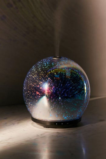 the crystal ball-style diffuser with the lights off so you can see it glow