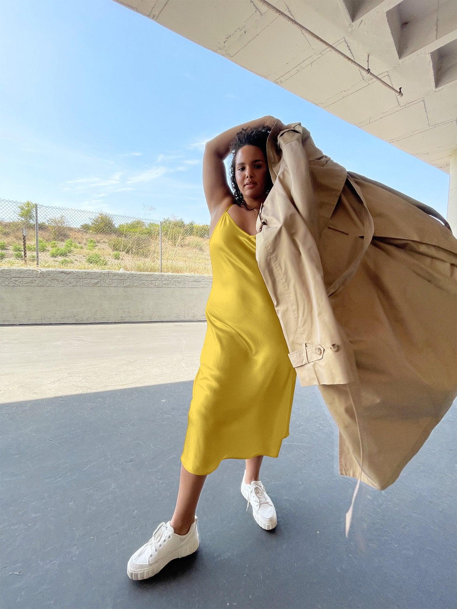 model wearing yellow slip dress
