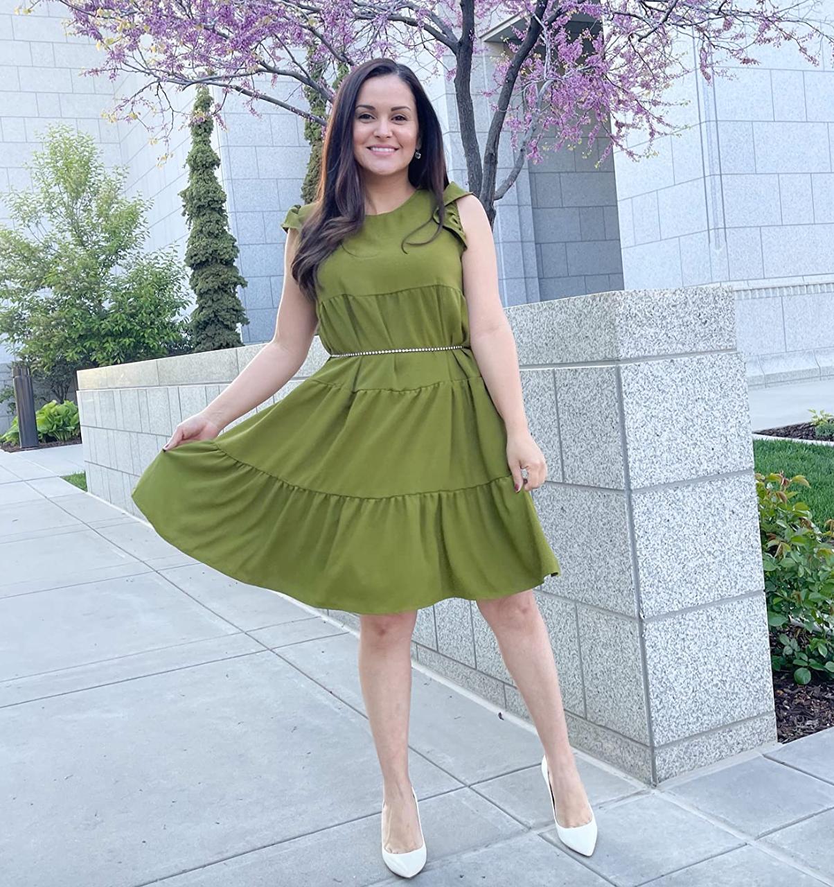 reviewer wearing green dress