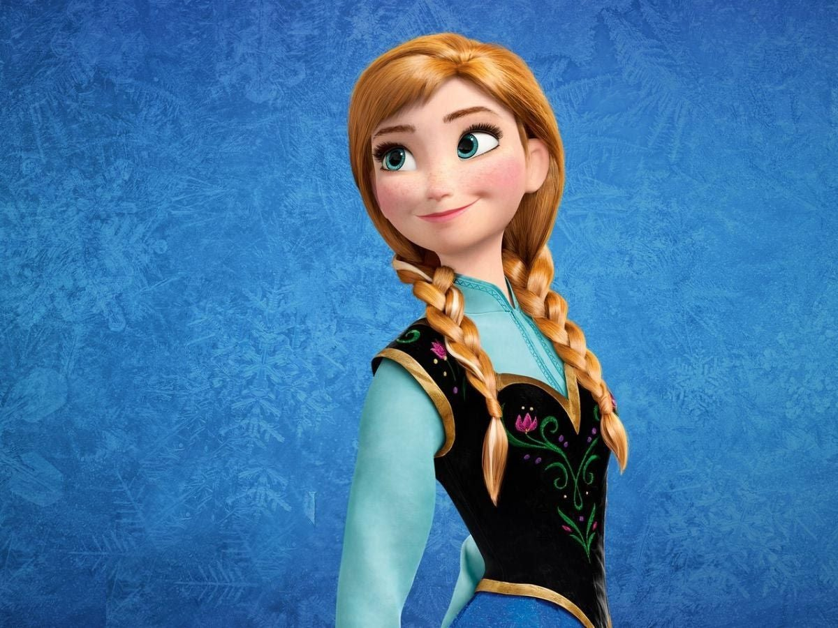 Anna from Frozen smiling brightly in the snow