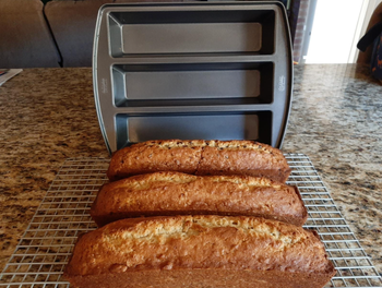 Three pieces of rectangular bread next to the pan
