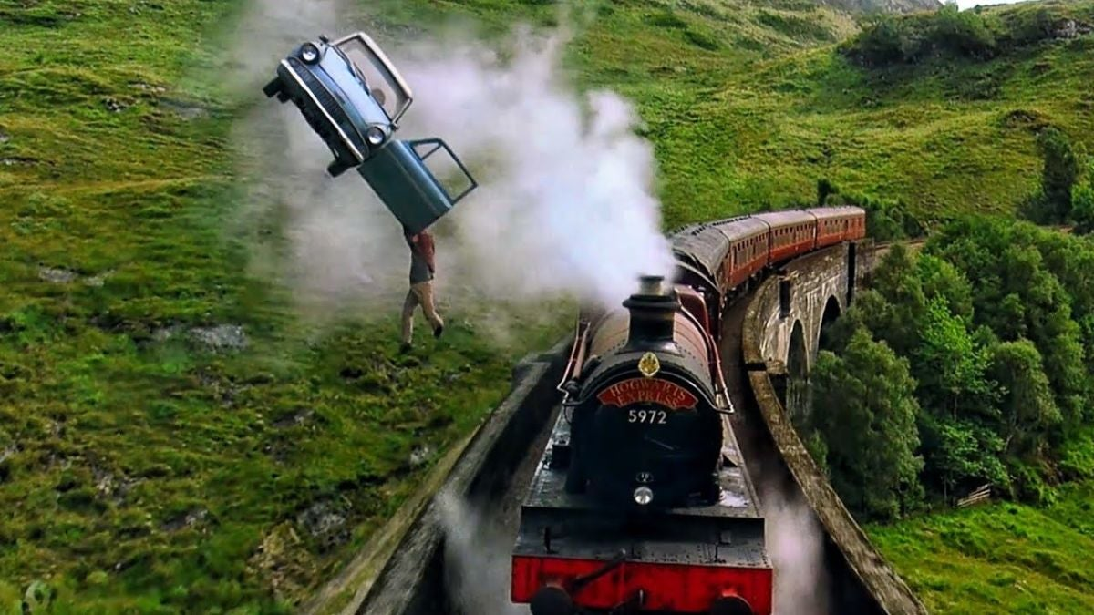 The Weasley's car hovers above the Hogwarts Express