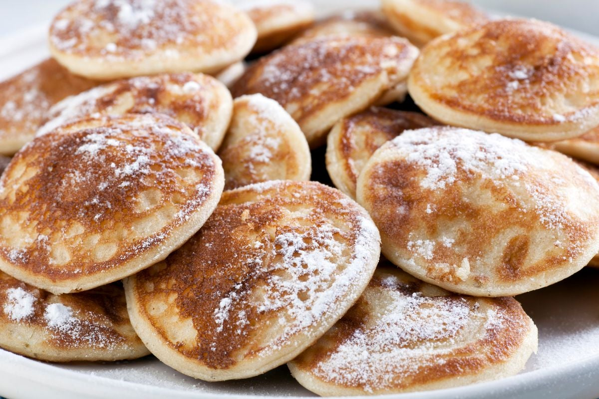 Mini pancakes topped with powdered sugar