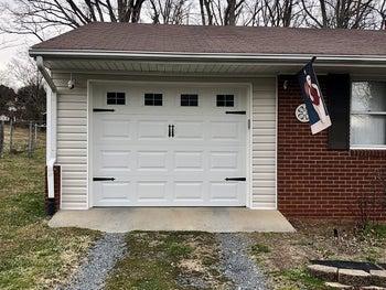 The same garage door with window decals and black handles
