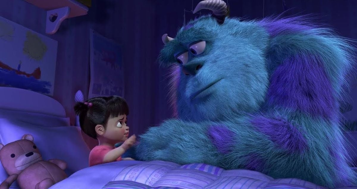 Sully looks at Boo who holds Sully's hand