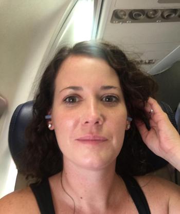 a reviewer wearing the blue earplugs