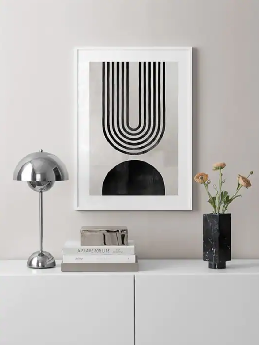 the black and white print with arches
