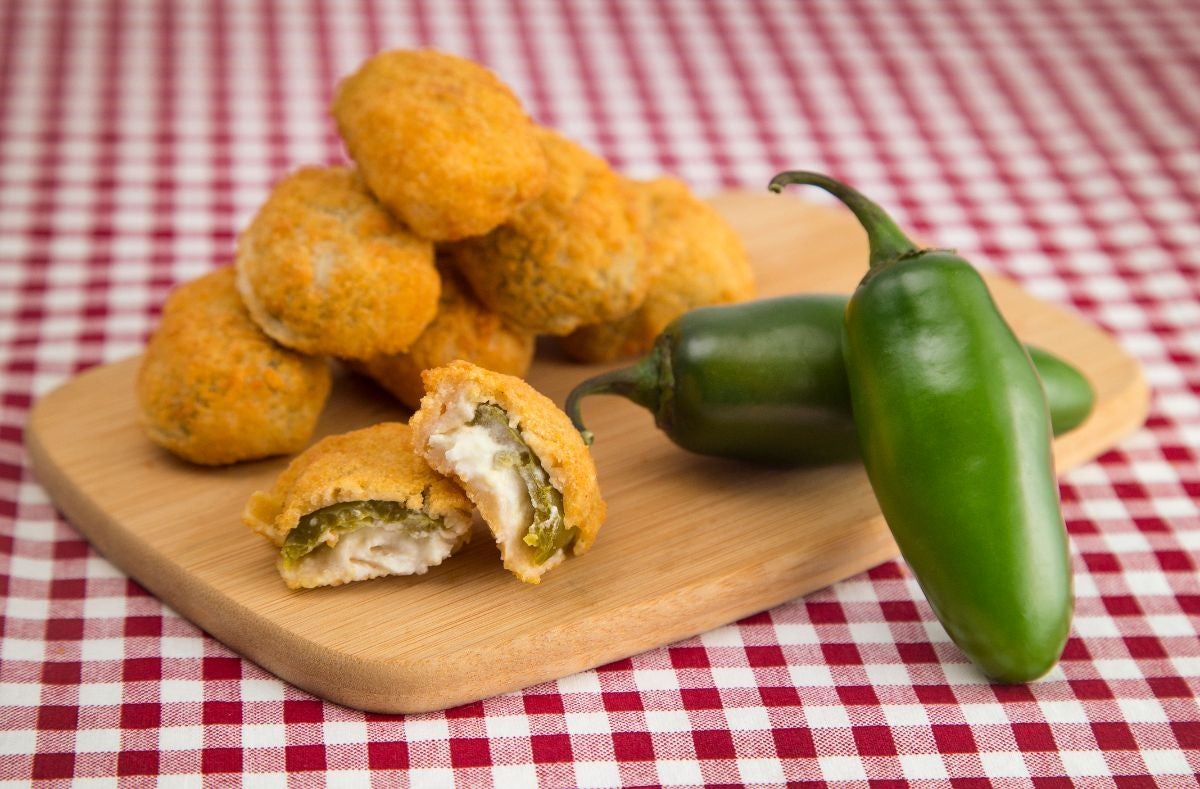 Jalapeños stuffed with cream cheese and fried and battered