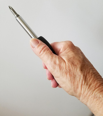 reviewer holding the compact screwdriver