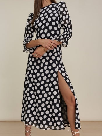 model wearing the black version with white polka dots
