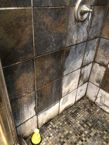 reviewer's shower tile with huge white stain