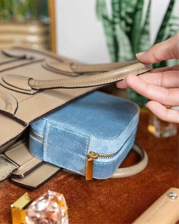 the blue case in a purse