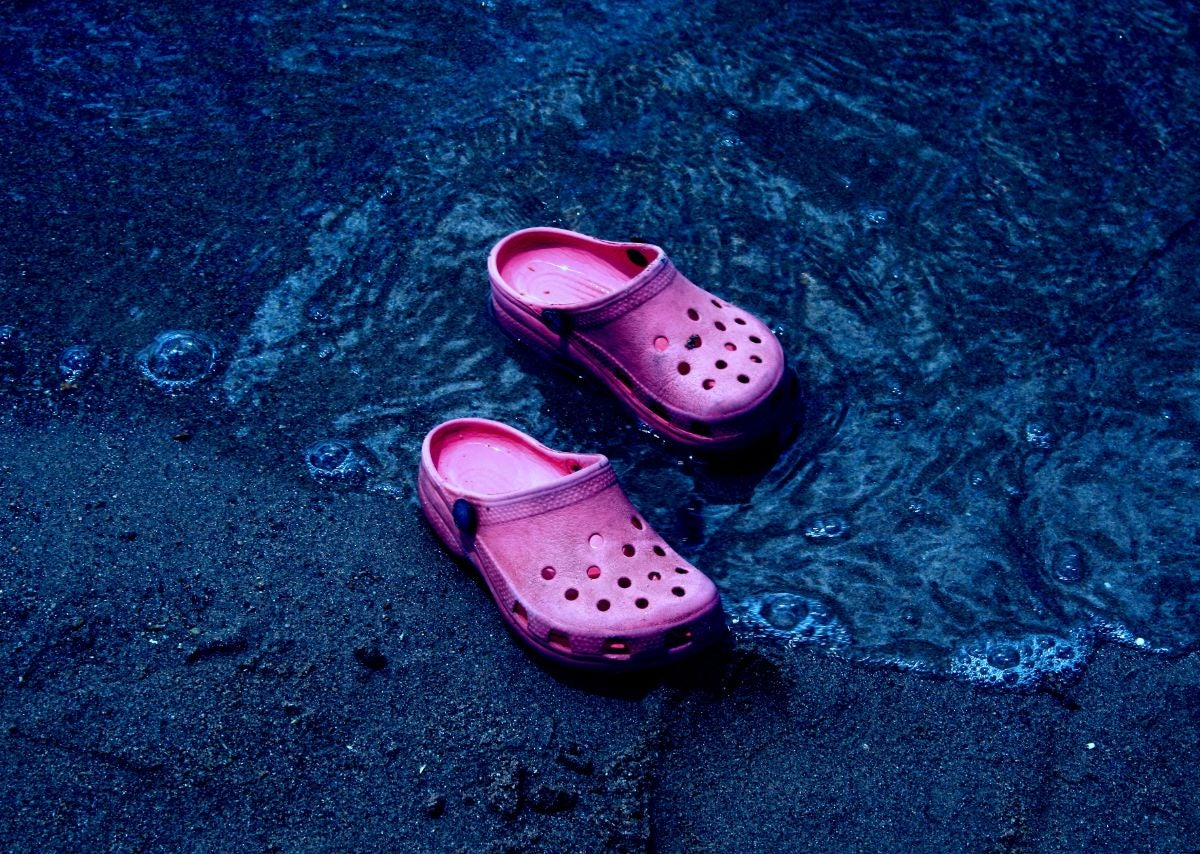 Pink sandals in the water