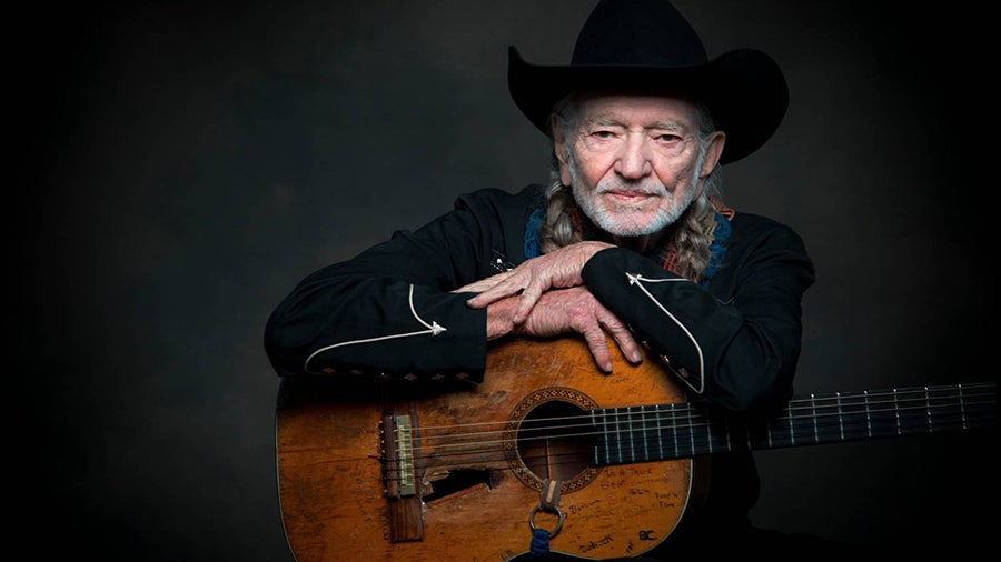 Willie Nelson just chilling with his guitar