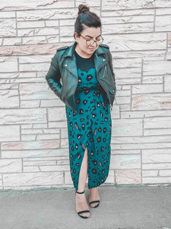 reviewer in teal version layered over a top and under a moto jacket