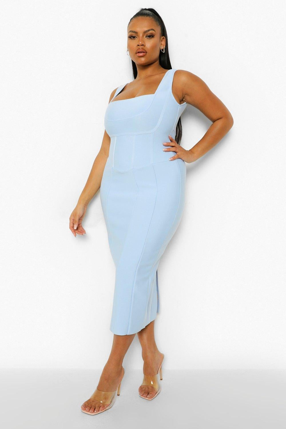 Model wearing bodycon baby blue midi dress with subtle seams on it