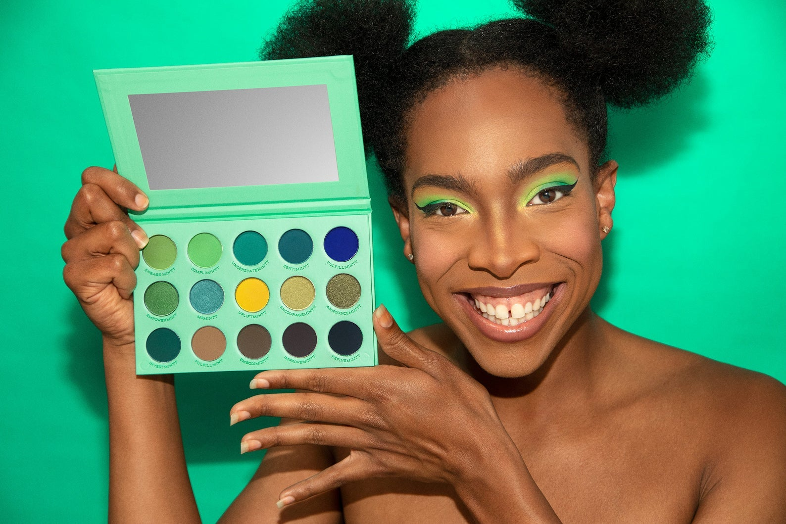 shop owner, junior mintt holding the mint colored eyeshadow palette