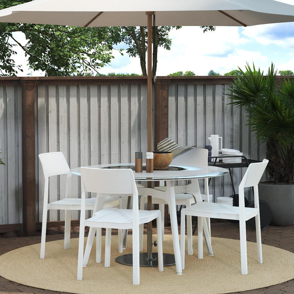 round outdoor able with an umbrella and white modern looking chairs
