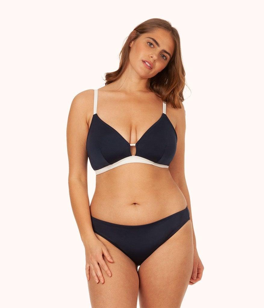 model wearing the navy and white bikini top