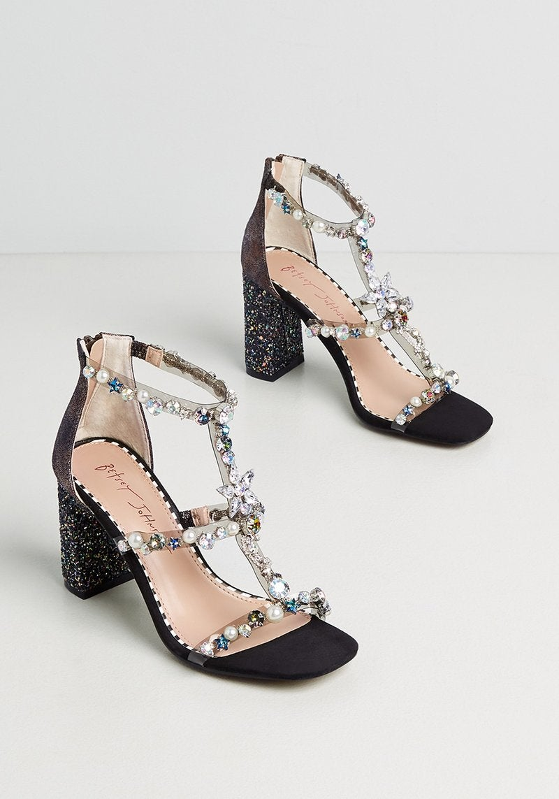 the black and bedazzled shoes