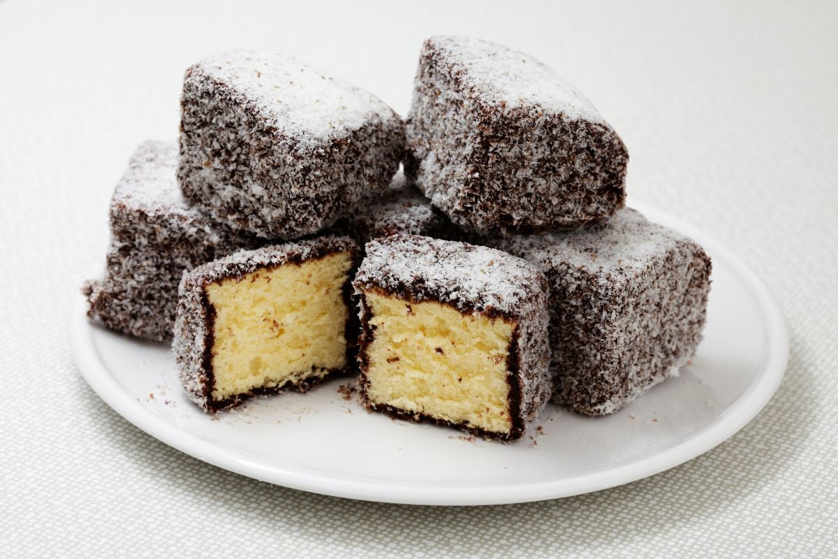 Small vanilla cakes enrobed in chocolate and covered in coconut