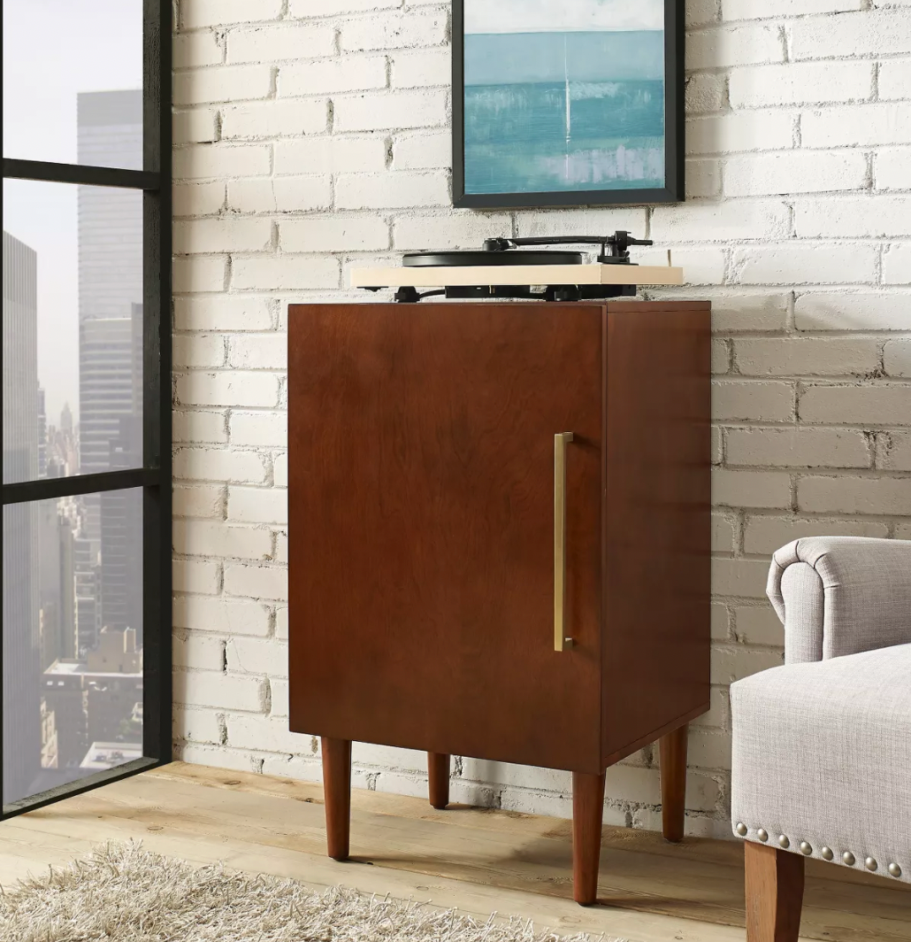a media cabinet with a record player sitting on top