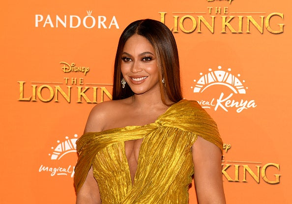 "Beyonce poses on the red carpet of the European premiere of Disney's ""The Lion King"""