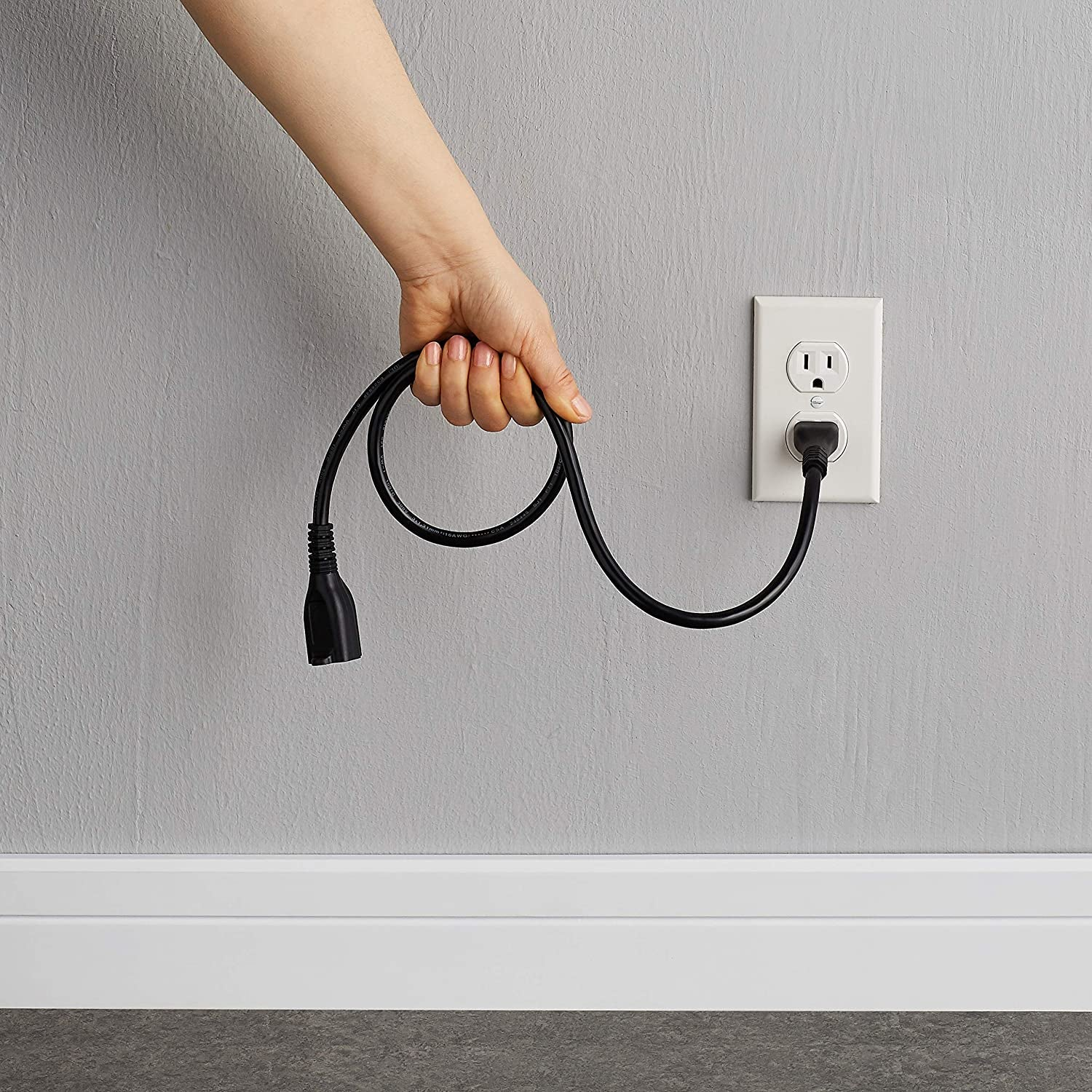 photo of a model holding the extension cord