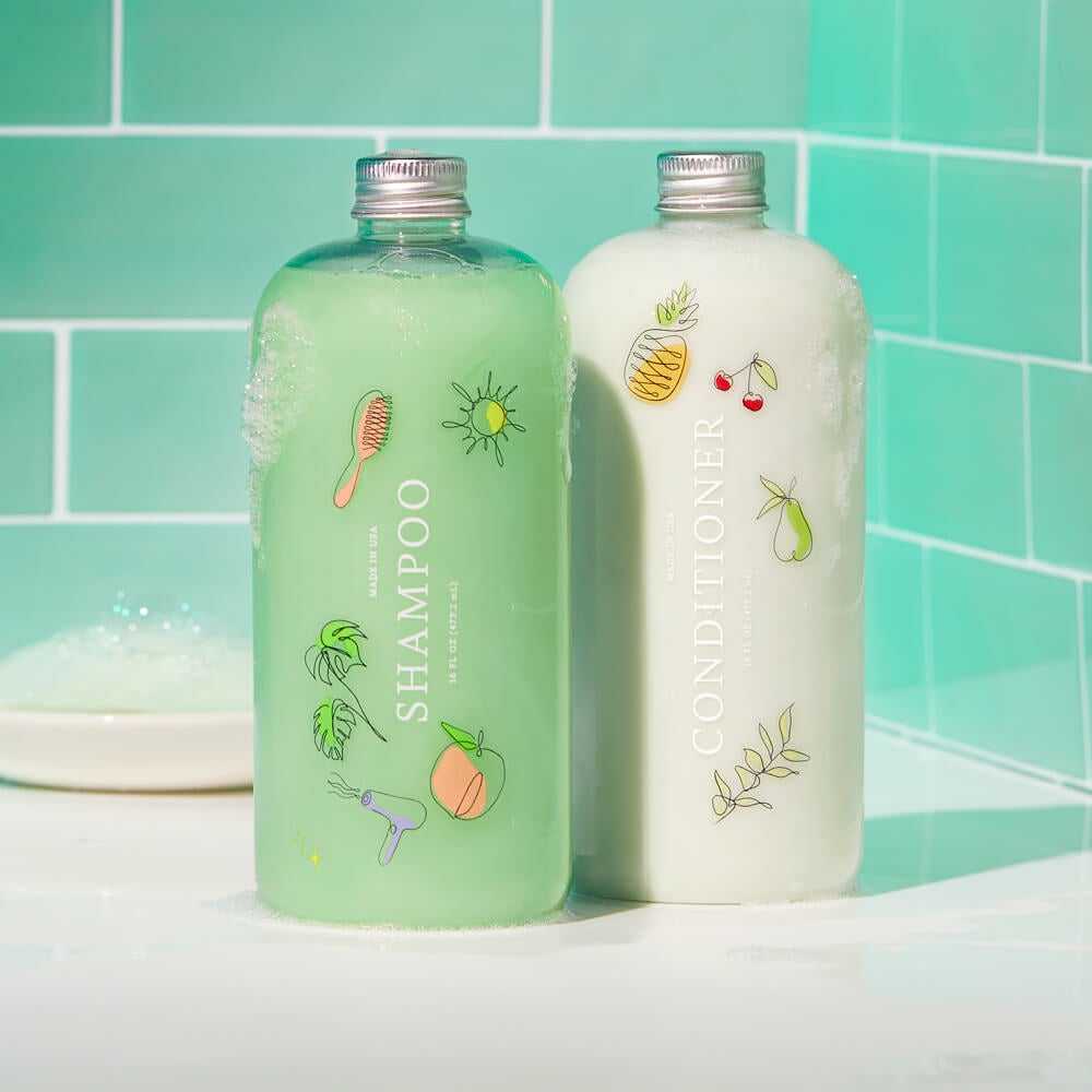 bottle of green shampoo and white conditioner