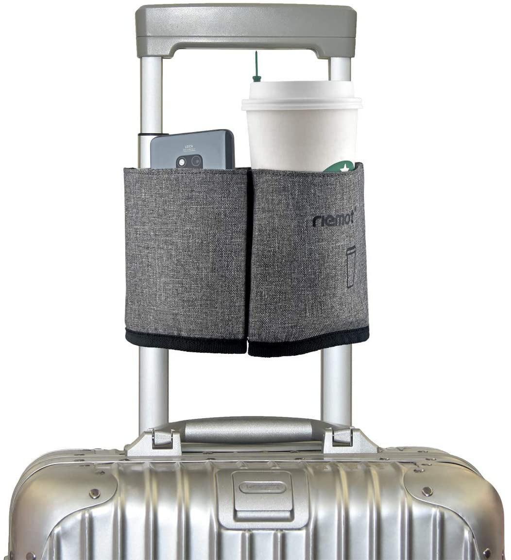 gray cup caddy holding a Starbucks coffee and cellphone attached to a carry-on suitcase handle