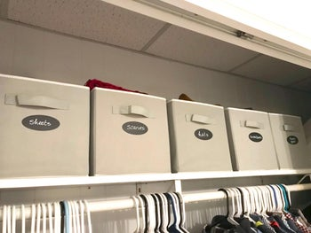 reviewer's storage cubes labeled and placed on top of a closet
