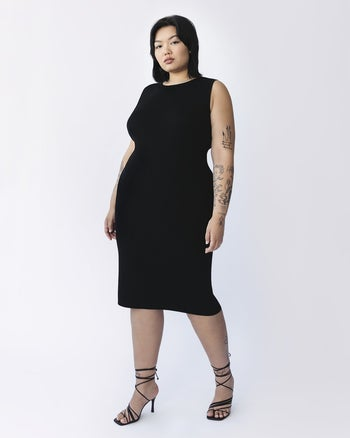 model wearing the black dress with black strappy heels