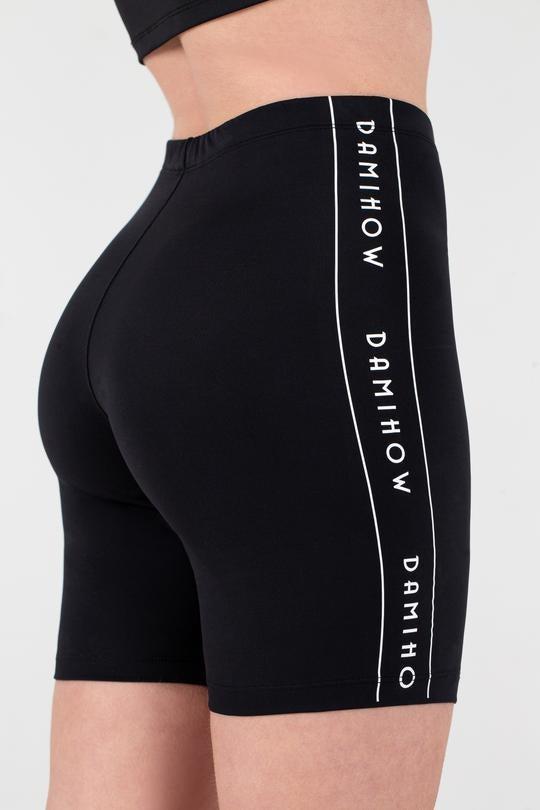 model wearing black biker shorts with