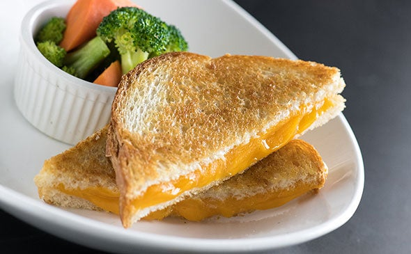 Grilled cheese with a side of steamed carrots and broccoli